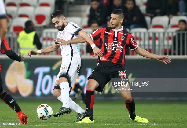 Younes Belhanda of Nice and Ryad Boudebouz of Montpellier in action during the French Ligue 1 match between OGC Nice and Monptellier Herault SC at...