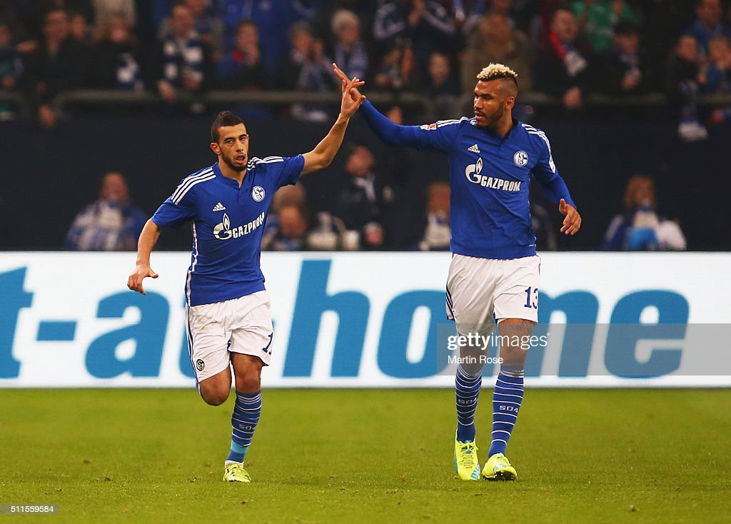 Younes Belhanda of Schalke (L) celebrates with team mate Maxim Choupo-Moting as he scores their first goal during the Bundesliga match between FC Schalke 04 and VfB Stuttgart at Veltins-Arena on February 21, 2016 in Gelsenkirchen, Germany.