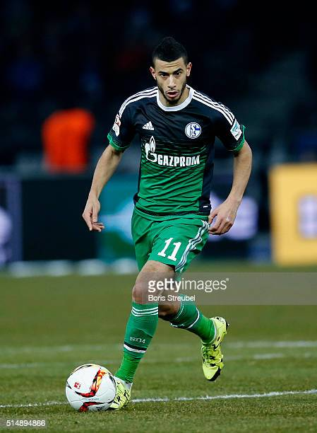 Younes Belhanda of Schalke runs with the ball during the Bundesliga match between Hertha BSC and FC Schalke 04 at Olympiastadion on March 11, 2016 in...