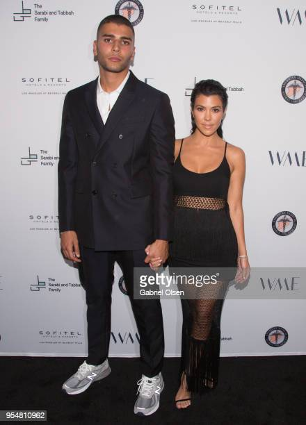 Younes Bendjima and Kourtney Kardashian arrive for The Syrian American Medical Society hosts the Voices in Displacement Gala at Riviera 31 at Sofitel...