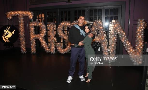 Younes Bendjima and Kourtney Kardashian pose for a photo as Remy Martin celebrates Tristan Thompson's Birthday at Beauty Essex on March 10 2018 in...