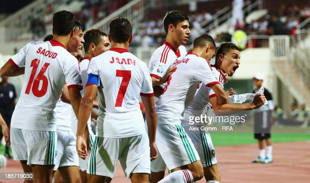 Younes Bnou Marzouk of Morocco celebrates his team's first goal with team mates during the FIFA U17 World Cup UAE 2013 Group C match between Morocco...