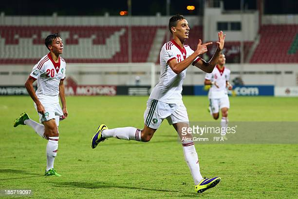 Younes Bnou Marzouk of Morocco celebrates his team's second goal with team mate Bilal Jellal during the FIFA U17 World Cup UAE 2013 Group C match...