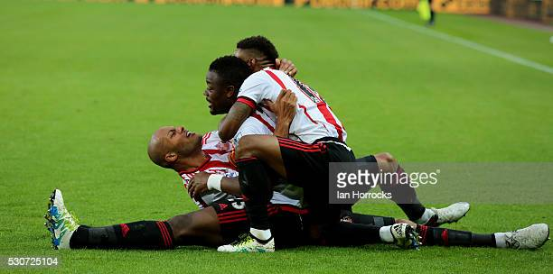 Younes Kaboul Lamine Kone and Jermain Defoe of Sunderland celebrate the second goal during the Barclays Premier League match between Sunderland and...