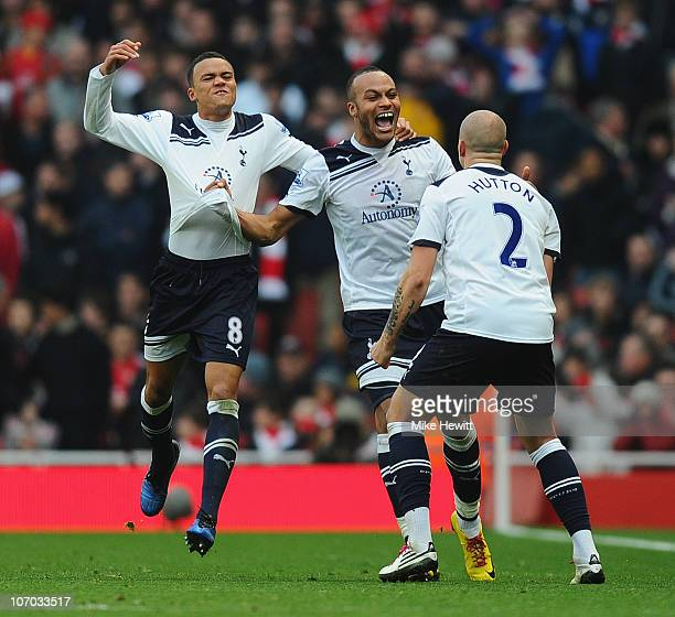 Younes Kaboul of Tottenham celebrates with team mates Jermaine Jenas and Alan Hutton after scoring the winner during the Barclays Premier League...