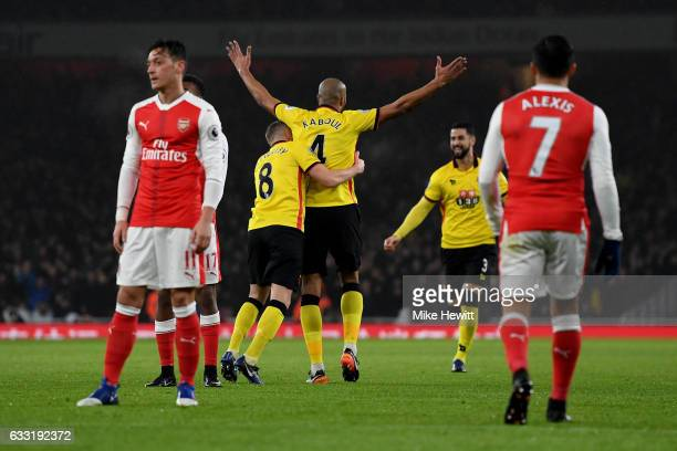 Younes Kaboul of Watford celebrates scoring the opening goal with his team mate Tom Cleverley during the Premier League match between Arsenal and...