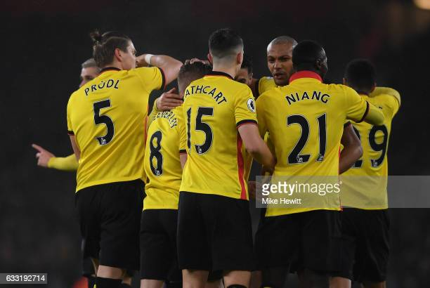 Younes Kaboul of Watford celebrates scoring the opening goal with his team mates during the Premier League match between Arsenal and Watford at...