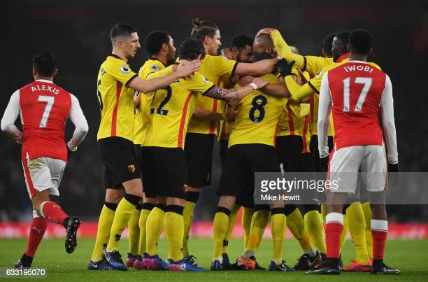 Younes Kaboul of Watford is mobbed by team mates after scoring the opening goal during the Premier League match between Arsenal and Watford at...