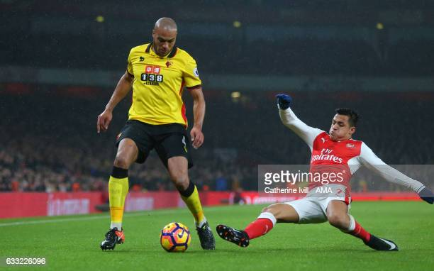 Younes Kaboul of Watford is tackled by Alexis Sanchez of Arsenal during the Premier League match between Arsenal and Watford at Emirates Stadium on...