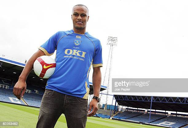 Younes Kaboul poses in his shirt as he signs for Portsmouth FC at Fratton Park on August 11 2008 in Portsmouth England