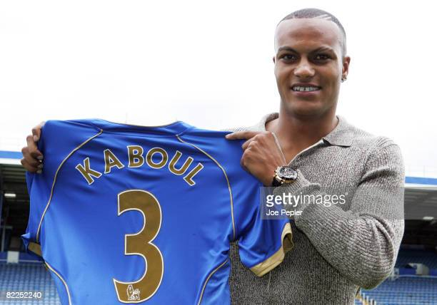 Younes Kaboul poses with his shirt as he signs for Portsmouth FC at Fratton Park on August 11 2008 in Portsmouth England