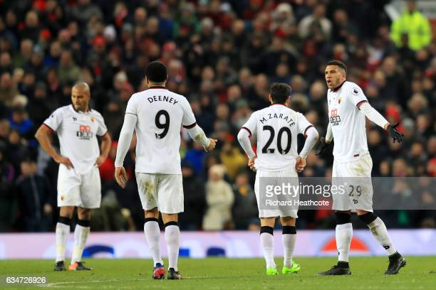 Younes Kaboul Troy Deeney Mauro Zarate and Etienne Capoue of Watford show their dejection after Manchester United's second goal during the Premier...