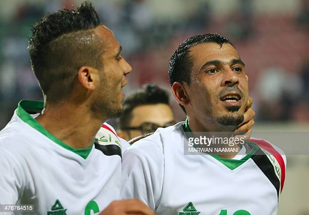 Younes Mahmood of Iraq celebrates with his colleague Ali Adnan Kadhim alTameemi after scoring the second goal for his team against China during their...