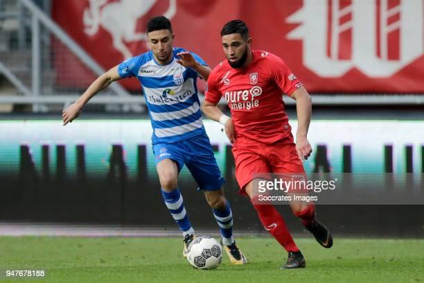 Younes Namli of PEC Zwolle Adnane Tighadouini of FC Twente during the Dutch Eredivisie match between Fc Twente v PEC Zwolle at the De Grolsch Veste...