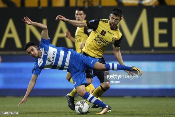 Younes Namli of PEC Zwolle Chris Kum of Roda JC during the Dutch Eredivisie match between Roda JC Kerkrade and PEC Zwolle at the Parkstad Limburg...