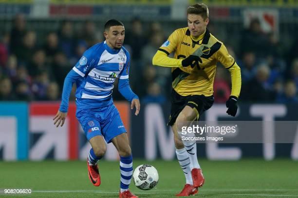 Younes Namli of PEC Zwolle Karol Mets of NAC Breda during the Dutch Eredivisie match between PEC Zwolle v NAC Breda at the MAC3PARK Stadium on...