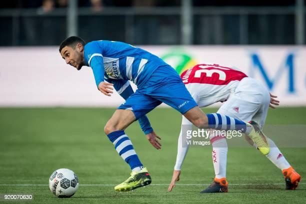 Younes Namli of PEC Zwolle Nicolas Tagliafico of Ajax during the Dutch Eredivisie match between PEC Zwolle and Ajax Amsterdam at the MAC3Park stadium...