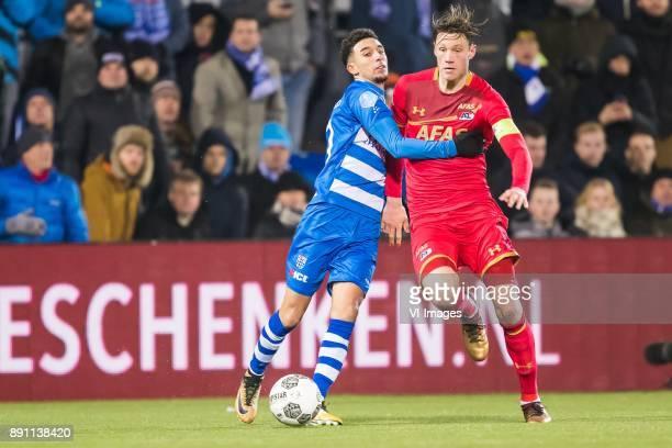 Younes Namli of PEC Zwolle Wout Weghorst of AZ during the Dutch Eredivisie match between PEC Zwolle and AZ Alkmaar at the MAC3Park stadium on...