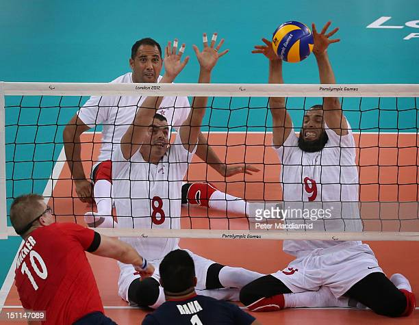 Youness Zaaboul of Morocco and teammate Hicham Aziani return a shot during the Men's Sitting Volleyball Preliminary Round Pool A match against Great...