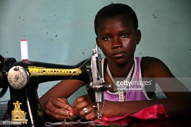 A young 14yearold Malian girl from the street project of the Jeunesse Developpement project learns how to sew in Bamako Mali The JD project supports...