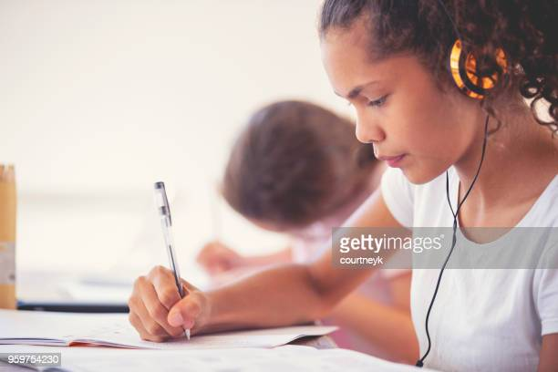 young aboriginal girls studying with headphones. - personal stereo stock pictures, royalty-free photos & images
