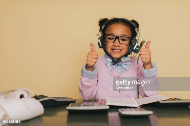 young accountant girl doing taxes at desk - vintage stock stock pictures, royalty-free photos & images