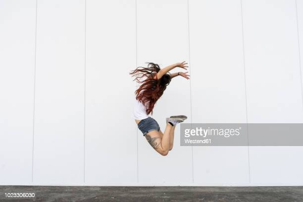 young acrobat jumping in air - entertainment occupation stock pictures, royalty-free photos & images