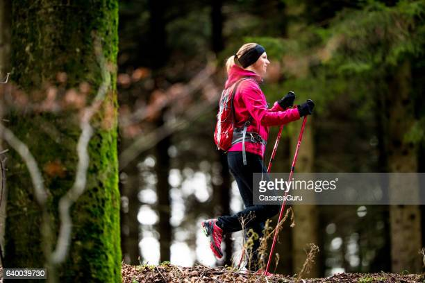 Young Active Woman Doing Trekking In The Forest