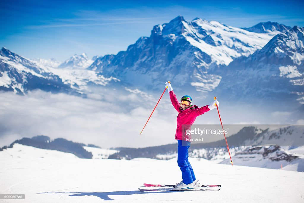 Young active woman skiing in the mountains. : ストックフォト