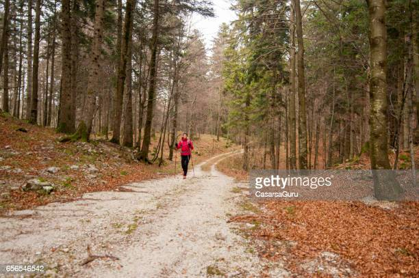 Young Active Woman Trekking In The Forest
