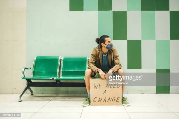 young activist / protester. human rights and social issues concept. - extremism stock pictures, royalty-free photos & images