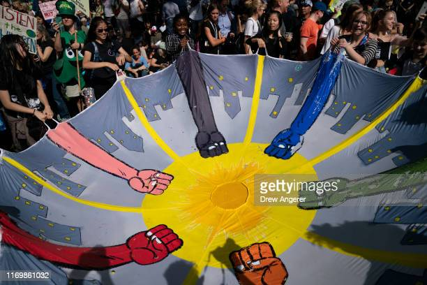 Young activists and their supporters rally for action on climate change on September 20, 2019 in New York City. Thousands of young people across the...