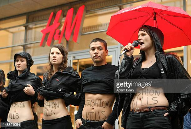"""Young activists from the labor rights group ver.di show their stomachs with the words """"Fashion Kills"""" written on them during a demonstration in the..."""