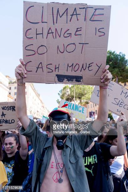 Young activists hold banners during the climate march 'Fridays for Future the Global Climate Strike for the planet launched by 16yearold Greta...