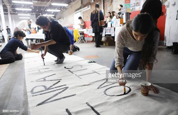 Young activists paint signs to be carried at the upcoming March for Our Lives Los Angeles on March 22 2018 in Los Angeles California More than 500000...