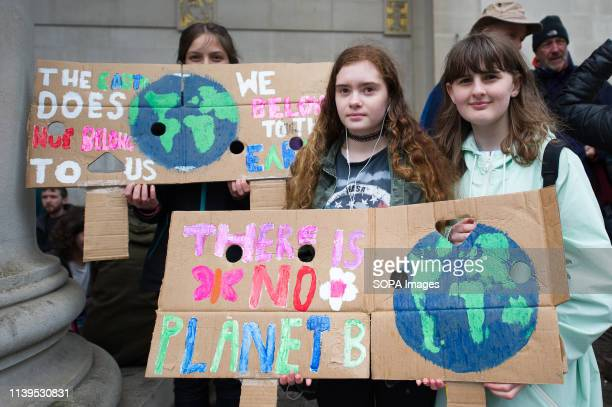 Young activists seen with climate change placards during the weekly Extinction Rebellion protest outside Manchester Central Library. Extinction...
