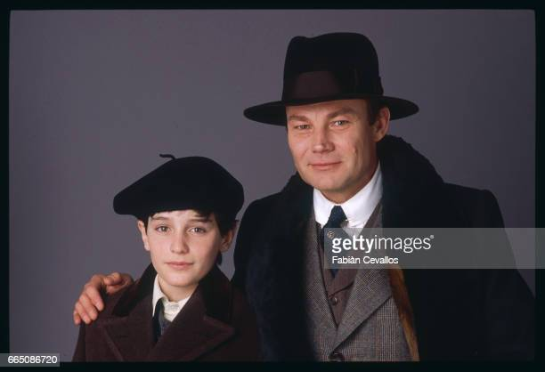 Young actor David Eberts and Austrian actor Klaus Maria Brandauer pose for a portrait during the shooting of the 1988 movie Burning Secret or...