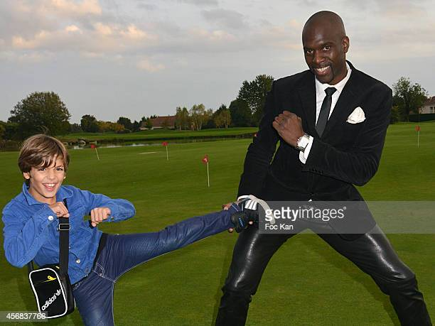 Young actor Enzo Tomasini and taekwondo champion Pascal Gentil attend the 'Tee Break Gourmand' Auction Golf Competition hosted by Matrix to benefit...