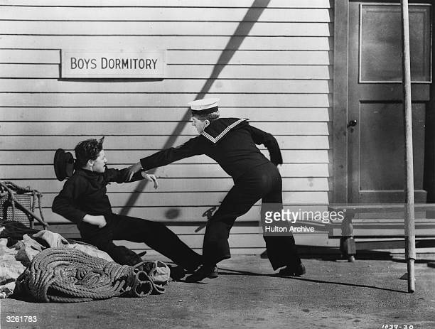 Young actor Freddie Bartholomew gets into a fight with Mickey Rooney outside a boys' dormitory in a scene from the film 'Lord Jeff' With the UK title...