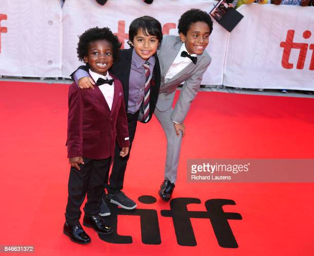 TORONTO ON SEPTEMBER 13 Young actors Aiden Akpan Callan Farris and Reece Cody seem to be enjoying themselves Movie Kings held a red carpet before the...