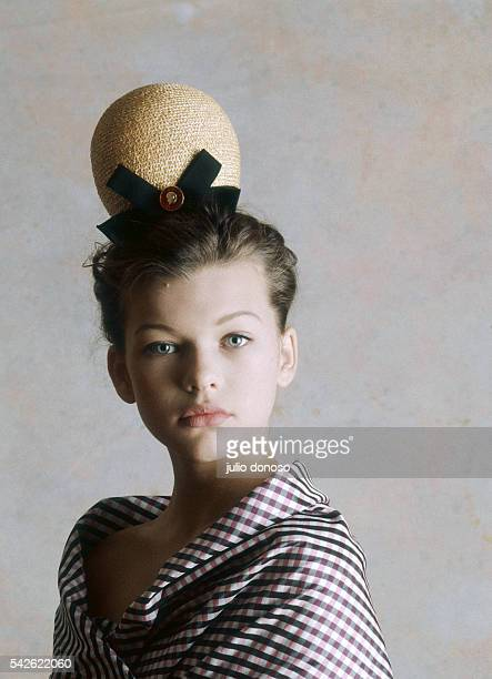 Young actress and fashion model Milla Jovovich at the age of twelve wearing a plaid shirt and hat by French designer Christian Lacroix Jovovich began...