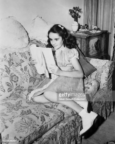 Young actress Elizabeth Taylor reading a script circa 1945