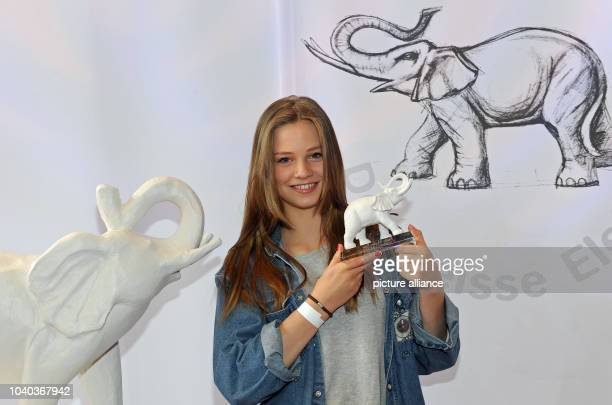 Young actress Hanna Binke poses with her award after the award ceremony of the children's media prize 'The White Elephant' as part of the Munich Film...