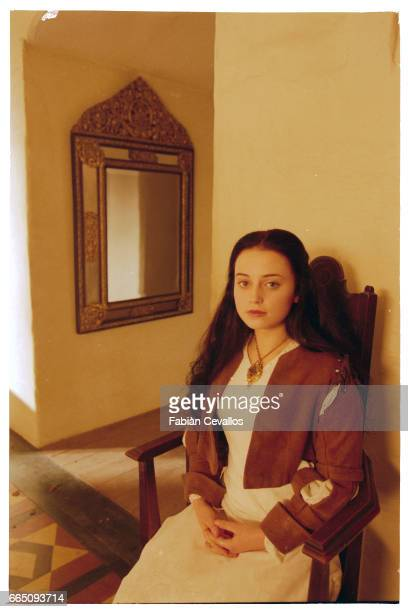 Young actress Monica Keena poses for a portrait with a mirror on the wall behind her on the set of the movie Snow White A Tale of Terror Directed by...