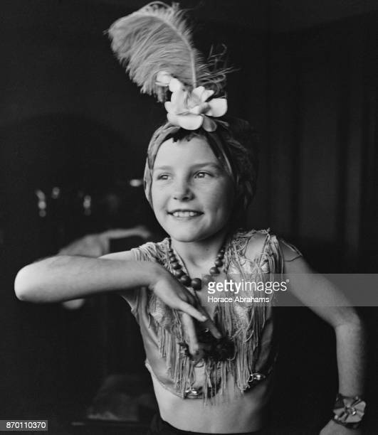 Young actress Petula Clark rehearses her impression of Carmen Miranda at her home in Chessington, UK, December 1942.