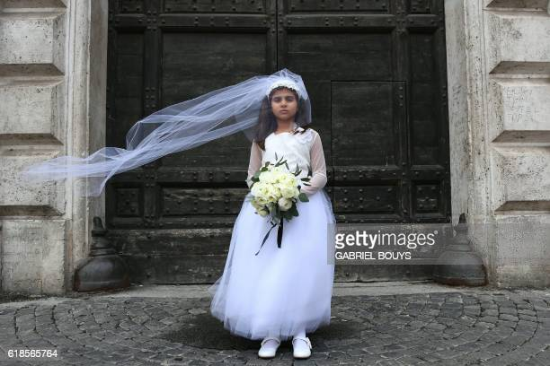 A young actress plays the role of Giorgia forced to marry Paolo during a happening organised by Amnesty International to denounce child marriage on...