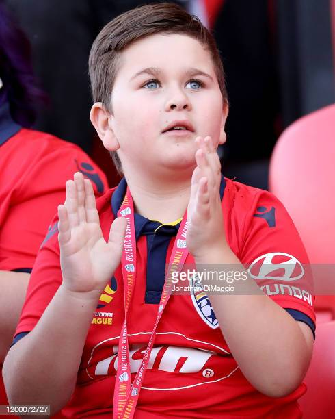Young Adelaide United fan cheering on his team during the round 15 A-League match between Adelaide United and the Melbourne Victory at Coopers...
