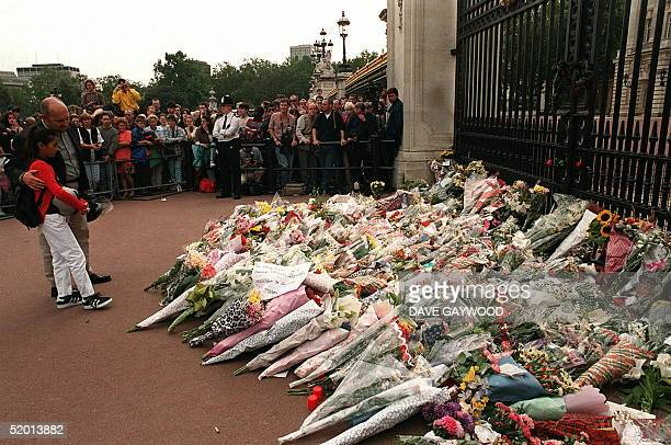 A young admirer of the late Diana Princess of Wales outside the gates of Buckingham Palace 31 August as the flowers begin to mount up after it was...