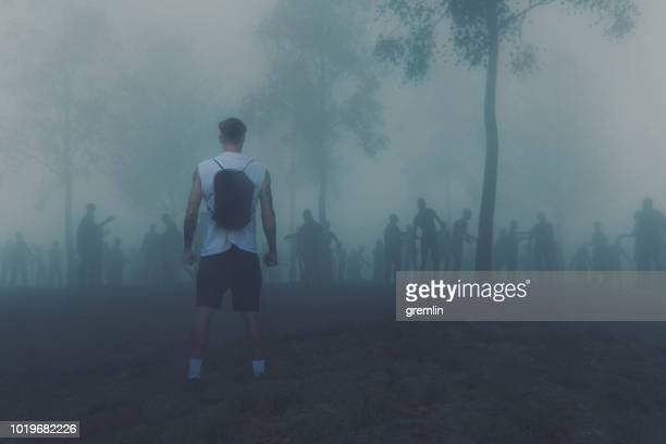 young adult against zombie hordes - apocalypse stock pictures, royalty-free photos & images