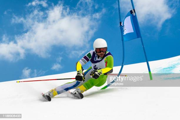 young adult alpine skier at giant slalom practice against the blue sky - アルペンスキー ストックフォトと画像